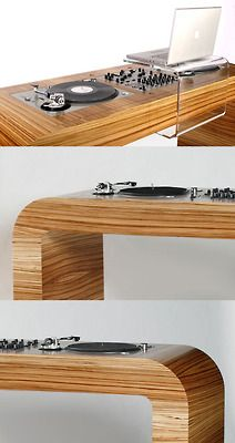 Would be a very cool set-up to have in your home! Sleek wooden table with a…