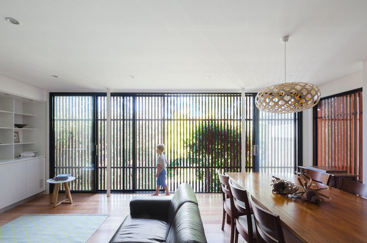 Escu House living room with timber screen — design by Bijl Architecture