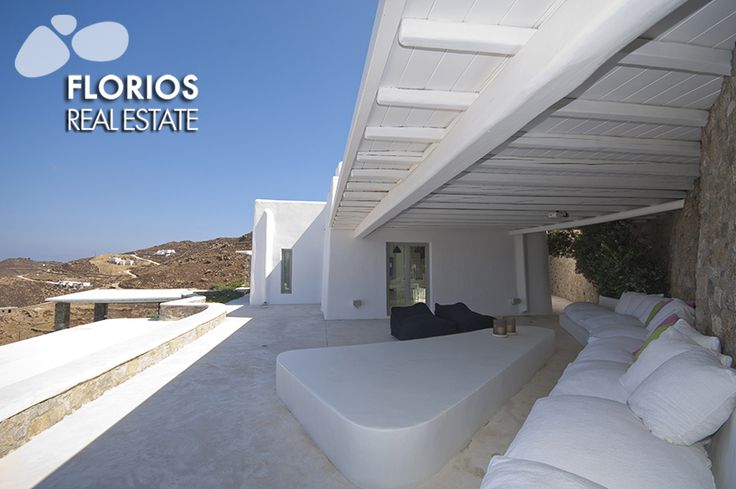 Outdoor area with sofa in front and area with sofa back. Luxurious Villa for Sale with extraordinary sea view, in Ftelia, Mykonos island, Greece. FL1467 http://www.florios.gr/en/mykonos-property/24.html