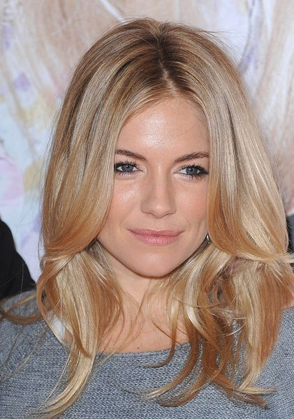 Sienna Miller's long layered blonde hairstyle