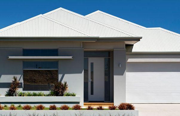 White roof, grey render