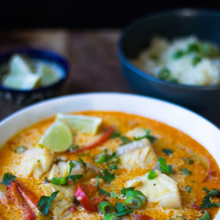 Brazilian Moqueca Fish Soup Recipe Soups, Main Dishes with coconut oil, olive oil, yellow onion, red bell pepper, yellow bell pepper, jalapeno chilies, garlic, paprika, cayenne, cod, sea bass, vegetable stock, coconut milk, lime, salt, pepper, green onions, yellow onion, garlic cloves, jasmine rice, vegetable stock, salt, pepper, green onions