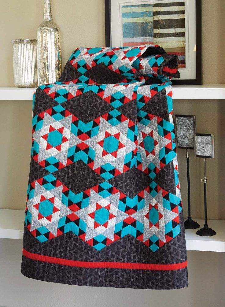 Tri-Angles quilt pattern: Foundation-pieced hexies take center stage in this modern quilt designed by Denise Starck.