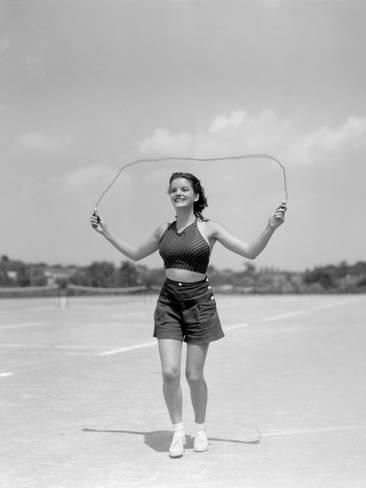 Smiling Teenage Woman Jumping Rope For Exercise Wearing Shorts and Polka Dot Halter Top Fotografie-Druck von H. Armstrong Roberts bei AllPosters.de