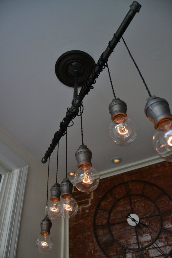 DESCRIPTION: This industrial light is flexible enough to work in a home, retail space, or office. This light uses our custom steel sockets combined with vintage cloth wire to hang the lights. From the ceiling to the Steel T bar is approximately 14(If you need a different length pipe to ceiling, please see item details and link below for additional options). Each Pendant comes with 4 of vintage twisted wire so you can hang the lights as high or low as you want. ALL PENDANTS ARE ADJUSTABLE…