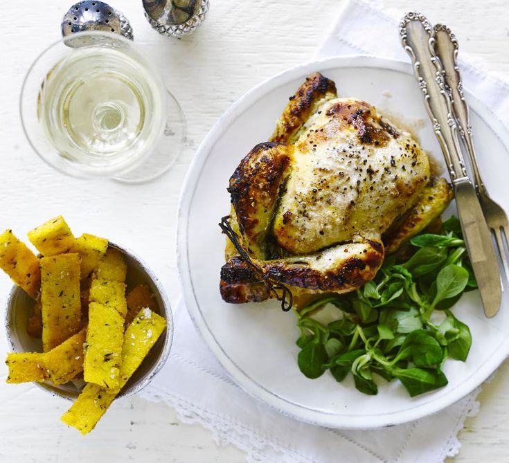 Treat yourself to this gourmet roast chicken and chips, marinated in buttermilk for juicy meat and roasted with lemon and thyme until crisp