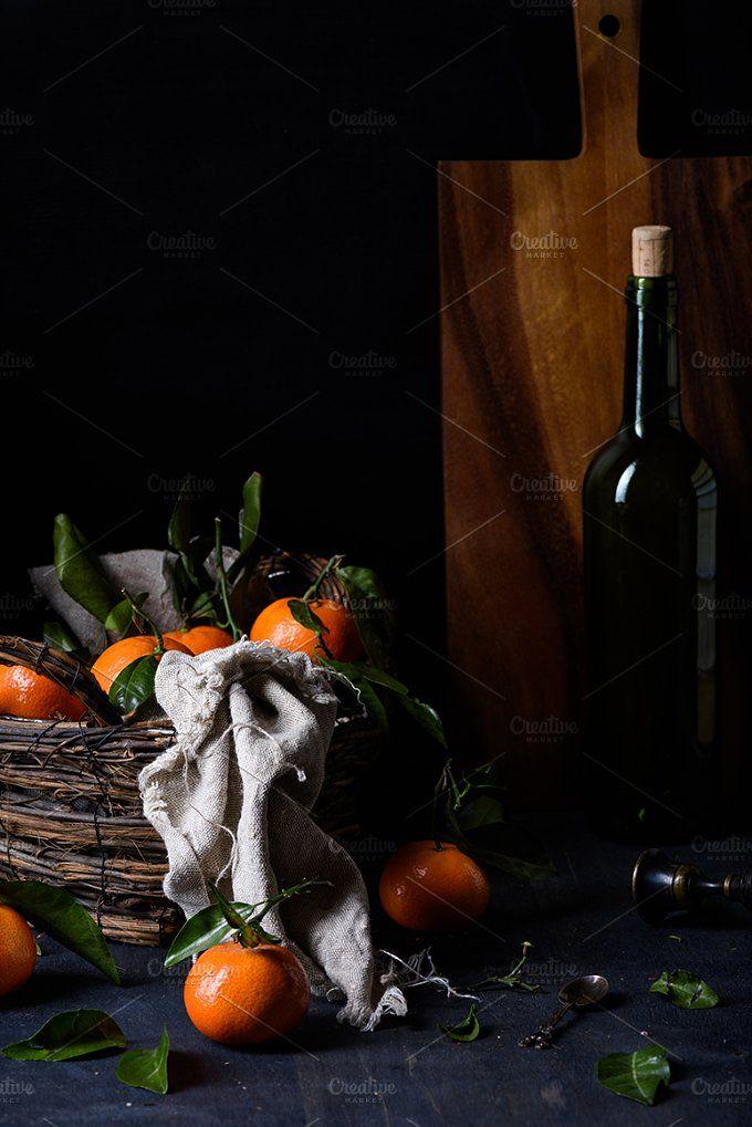 Ripe clementines in a basket  by Iuliia Leonova on @creativemarket