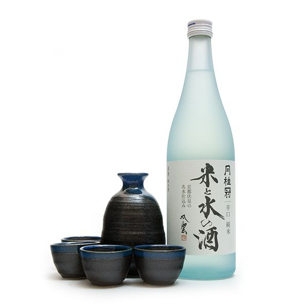 A traditional Japanese sake set, including one tokkuri dispenser, four ochoko cups, and one bottle of Gekkeikan junmai sake, or pure rice wine.