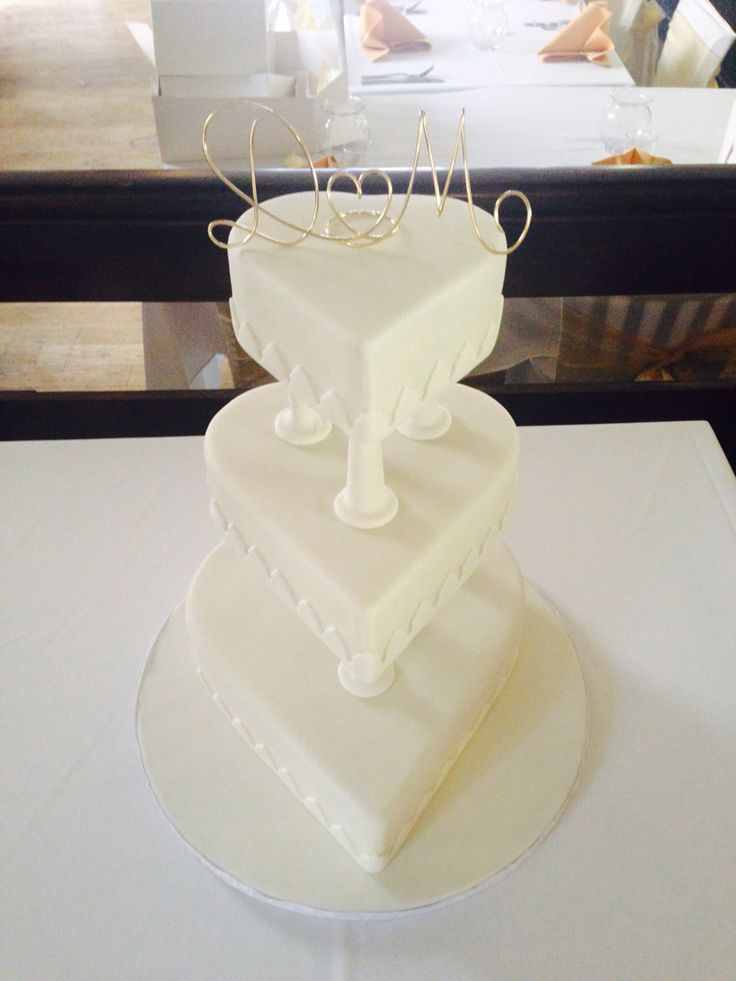 3-tier Ivory Heart Wedding Cake separated by pillars