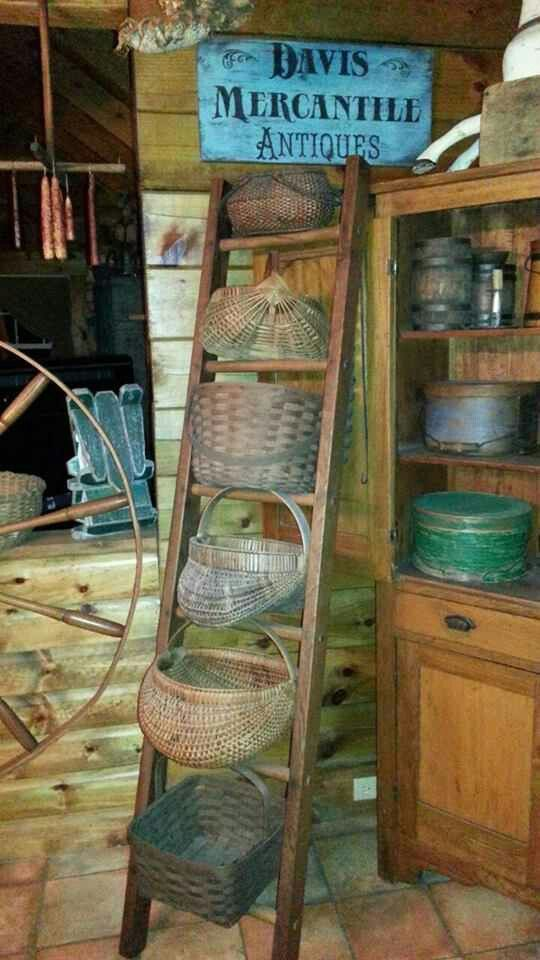 Ann Davis photo ~ love the baskets on the old ladder...