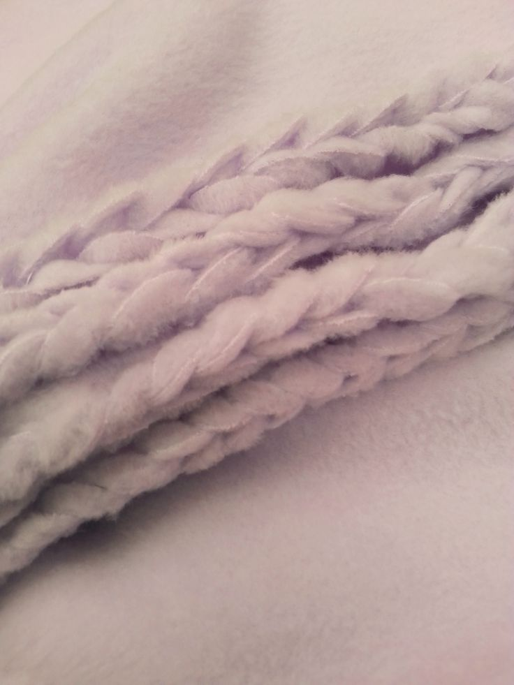 """This is a fun way to finish the edge of a simple fleece blanket that is similar to a """"tie-blanket""""more sophisticated look."""