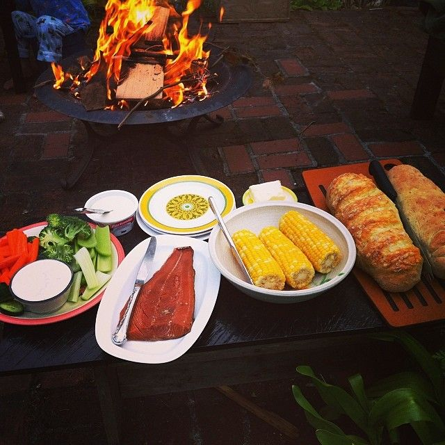 Breaking all the rules with dinner.  Fireside. Smoked salmon.  Fresh corn and homemade bread topped with #cdncheese #simplepleasures