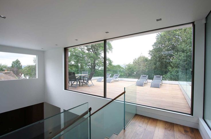 Slim Framed Sliding Doors Leading Out Into A Roof Terrace