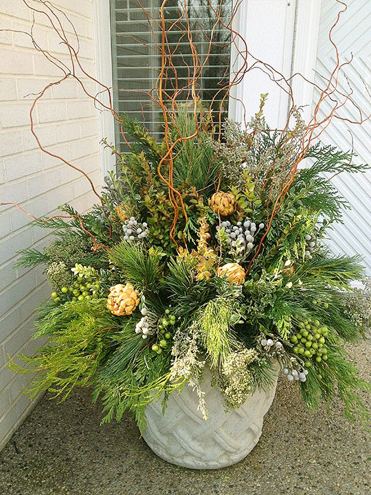 Love the pop of gold and the twisted willow in this container.