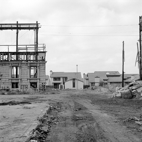 The backlot of MGM Studios during demolition. The new sub-development can be seen in the background.