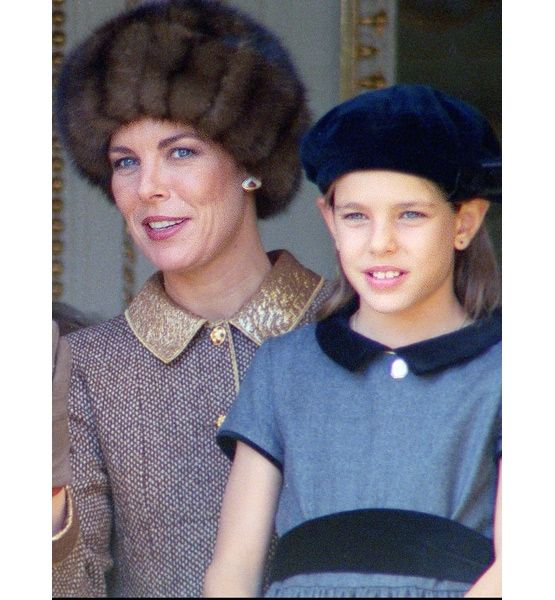 Princess Caroline of Monaco and her daughter, Princess Charlotte, are pictured on a balcony during National Day in Monaco City, 19 Nov. 1996.