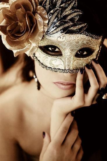 Masquerade Mask.. maybe not the giant flower, but love the gold