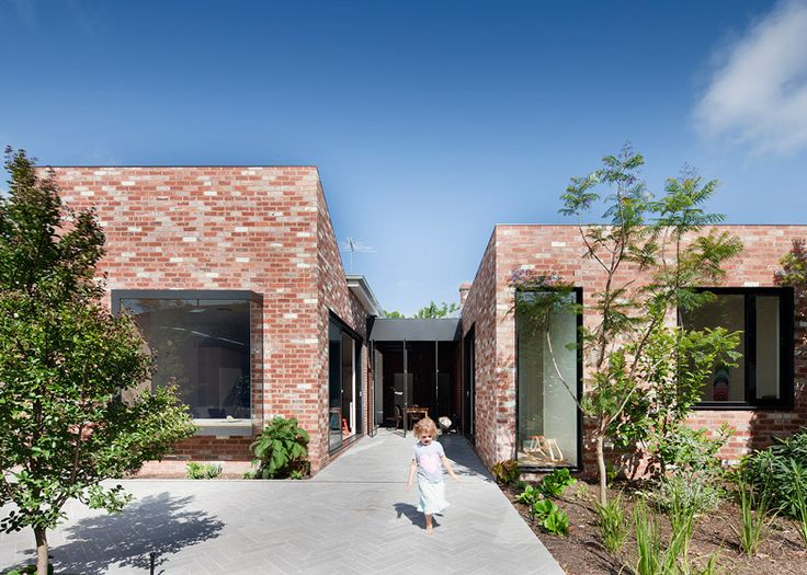 Victorian house renovation by Clare Cousins features a courtyard dining room.
