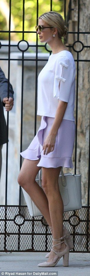 The looked elegant in a lilac purple skirt featuring ruffles and a stark  white top
