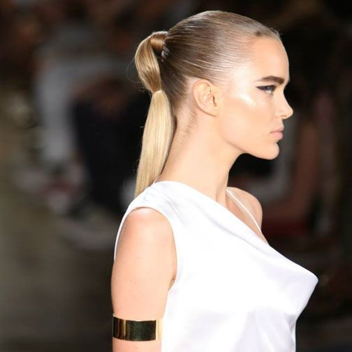 Cushnie et Ochs Spring 2015 #hairstyles  sleek ponytail with a double elastic. The sleek ponytail was banded twice to create a shape reminiscent of the scarab beetle.