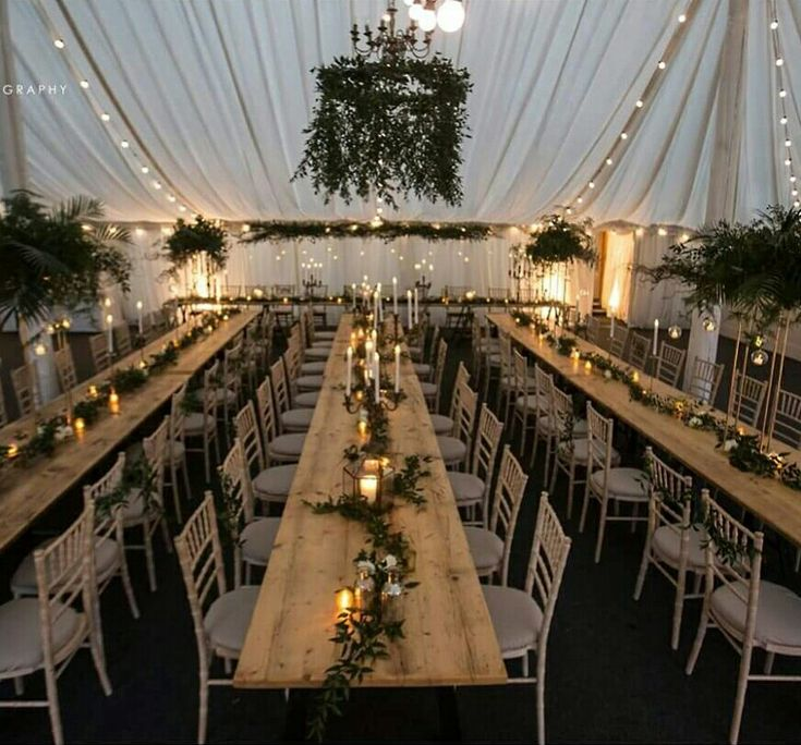 The beautiful Marquee at Middleton Lodge all set for the evening with our Botanical Wedding styling. Foliage chandelier, brass hexagonal Lanterns, Candelabra, hanging tea light globes and lots of greenery & foliage. North Yorkshire Wedding Flowers
