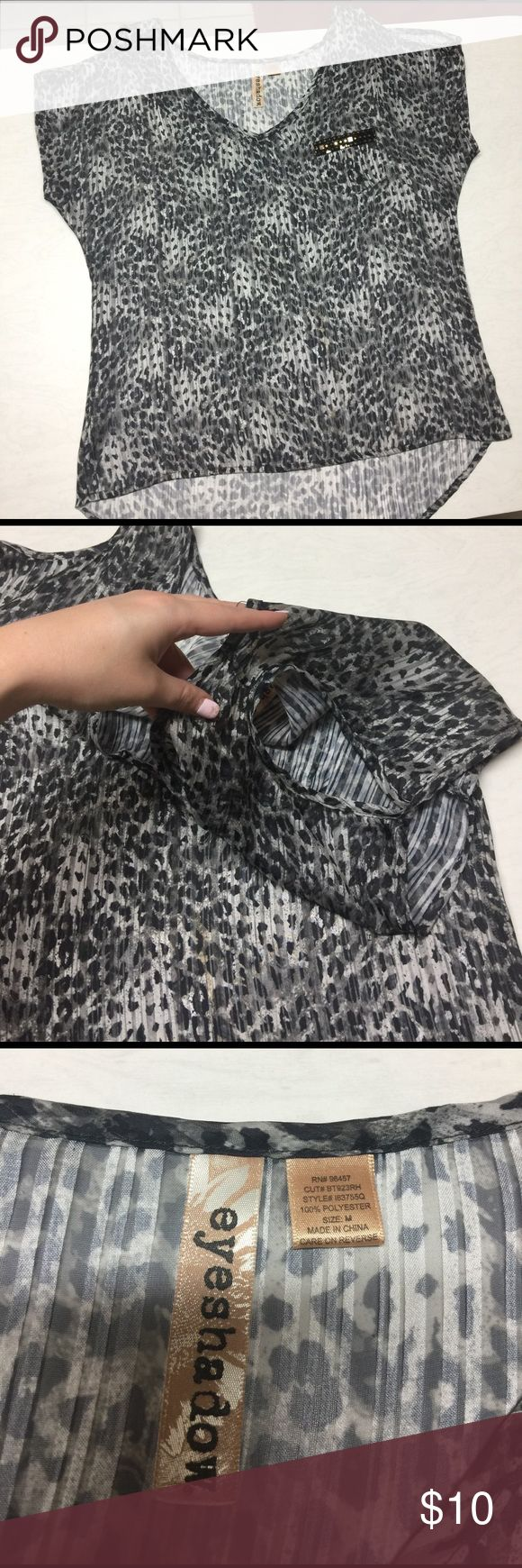 Open shoulder leopard top Open shoulder leopard top with high low bottom. Has gold and black sequins on pocket. Eyeshadow Tops