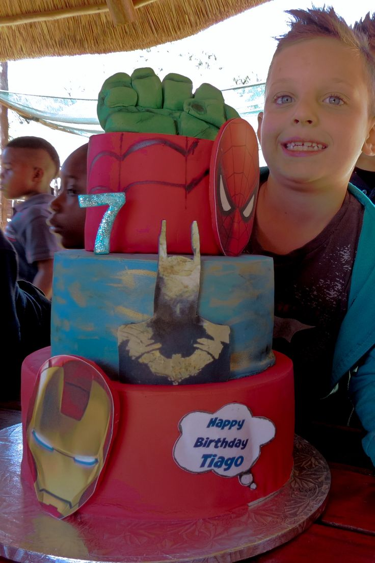 Superhero Cake. Iron man, batman, spiderman and hulk fist.