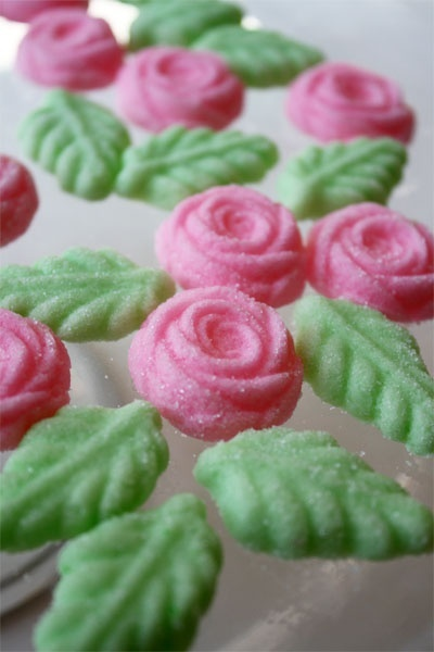 Cream Cheese Mints Roses, my mom has made these for years, even has the rose and leave candy mold, only we left them white