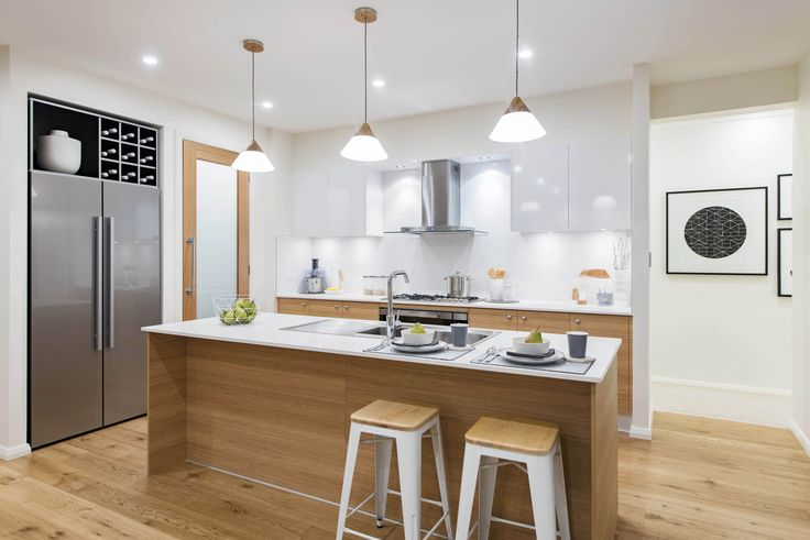 Never ending timber finishes in the #kitchen of the Stoneleigh on display in Moncrieff, featuring a #Scandinavian #interior #style. For details and more photos see http://mcdonaldjoneshomes.com.au/display-home-locations/moncrieff. #scandi #furniture #interiordesign #interiorstyle #décor #decorate #home #newhome #kitchen #timber #wood #natural #organic #cupboard #benchtop #bench #pendantlights #pendant #lighting #neutral #floorboards #stool #stools #splashback