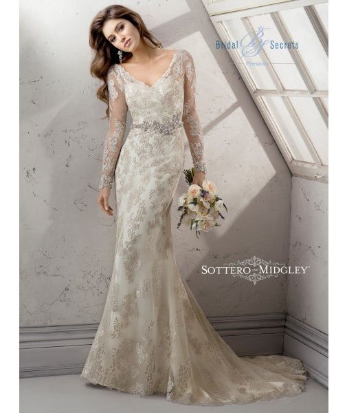 """Connect with your inner goddess with the alluring Sottero & Midgley Anastasia bridal dress. This sheath style wedding dress presents a flattering V-neckline, dramatic sleeve embellishment leading into an illusion back cut. The skirts flows down glamorously to a sweep train, with an Orlando satin underlay, magnificent tulle overlay and glimmering metallic embroidered lace from … Continue reading """"Sottero & Midgley Anastasia"""""""
