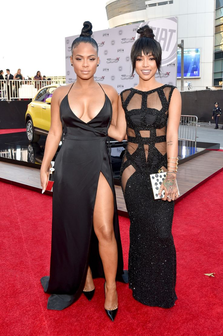 dhopeechiick: heykarrueche: celebritiesofcolor: Christina Milian and Karrueche Tran attend the 2015 American Music Awards at Microsoft Theater on November 22, 2015 in Los Angeles, California. I wanna like this look, but I cant They should switch dresses.