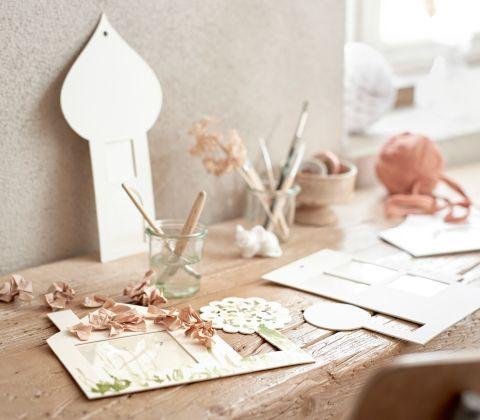 Štyri papierové rámy v tvare rôznych domčekov, ktoré môžete vyfarbiť alebo upraviť podľa vašich predstáv.