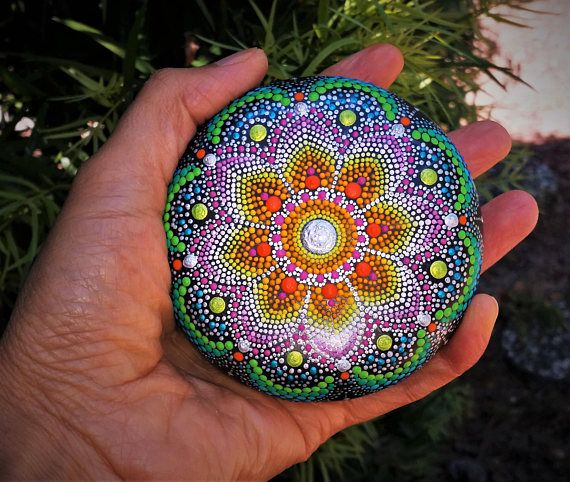 Mandala Hand Painted Stone This precious stone was created with much love and joy. The mandala stones have in them many hours of joyful work and prayer for the owner to feel the vibration of joy, happiness and worth of our beautiful Universe. Size: 8.5cm.in diameter/ 3.35inch. I use a natural stone as this is the best canvas to paint and express my love for color and my gratitude to Mother Earth. The stone hand painted mandala must be handled with care and they are not suitable for ch...