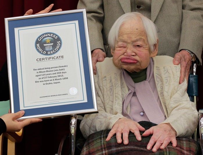 Misao Okawa, aged 114, poses with a certificate confirming her to be the world's oldest woman, at a nursing home in Osaka, western Japan