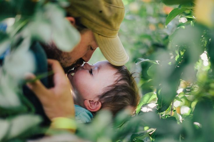 photography lacey monroe's image of litle boy and dad framed by leaves