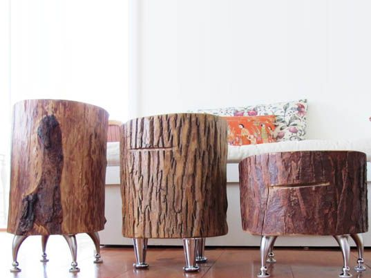 Don't these guys look like they might walk about like little robots? They are tree trunk tables made in Canada.