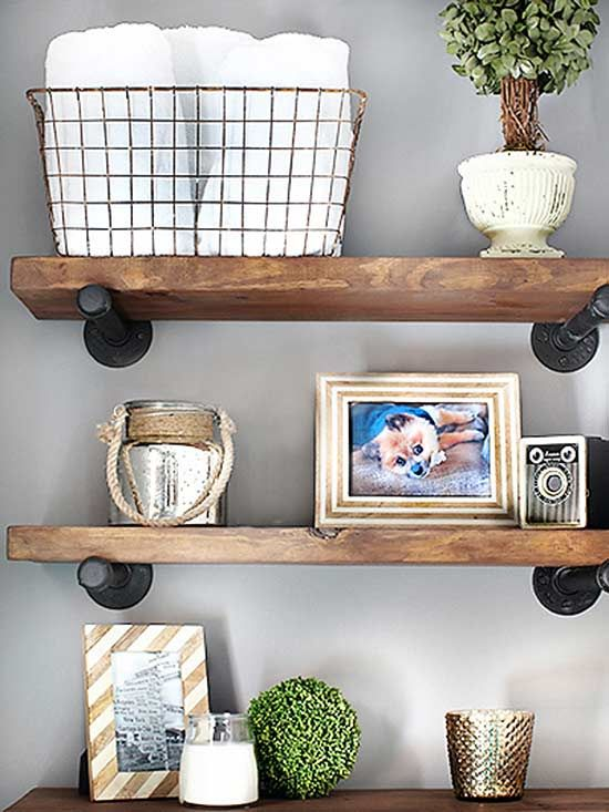 A DIY project tackled over a three-day weekend, this shelving is a worthy knock-off of Restoration Hardware's Distressed Pine Shelves. To mimic the cast metal rods, the husband-and-wife team transformed galvanized pipe with two types of spray paint. Once secured to the wall, the brackets were able to support framing boards distressed and stained for an aged look.