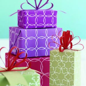 make your own distinct patterned gift wrap paper using cookie cutters and acrylic paint.