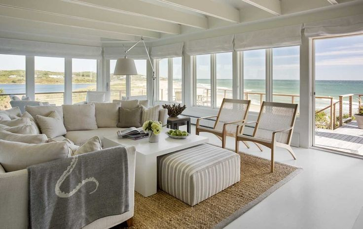 With breathtaking oceanfront views at every turn, this stunning beach house designed by Martha's Vineyard Interior Design is sited in Vineyard Haven, Mass.