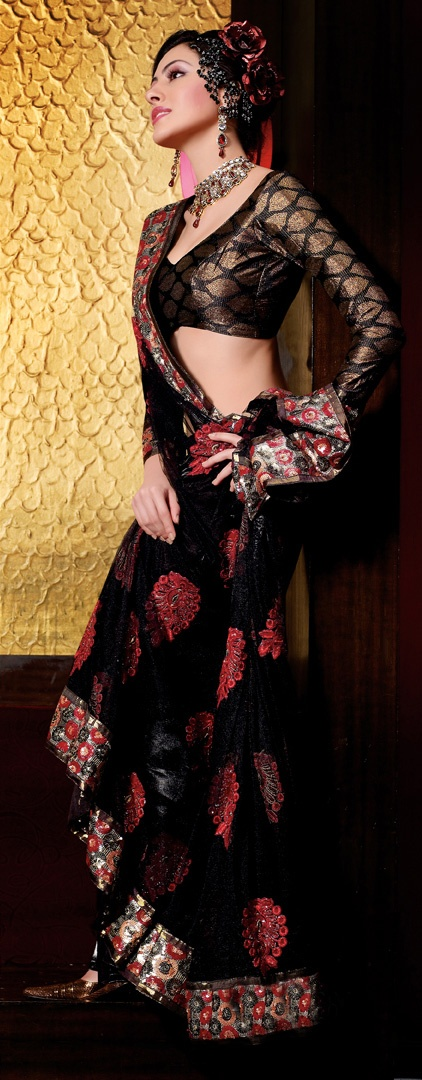 Black net saree embellished with sequins #saree #indian wedding #fashion #style #bride #bridal party #brides maids #gorgeous #sexy #vibrant #elegant #blouse #choli #jewelry #bangles #lehenga #desi style #shaadi #designer #outfit #inspired #beautiful #must-have's #india #bollywood #south asain
