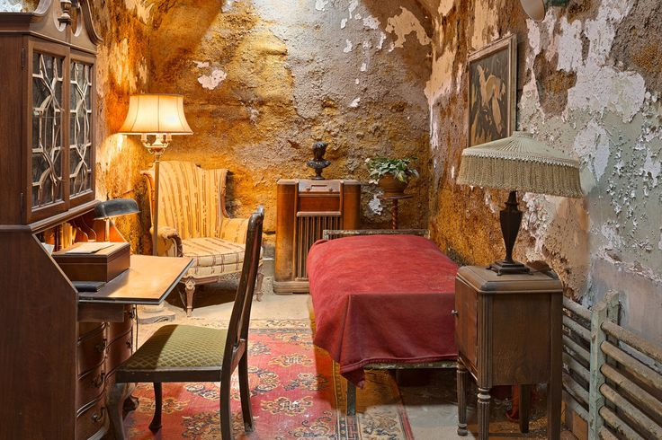 Abandoned prison cell furnished and decorated in luxury, from the Eastern State Penitentiary in Philadelphia, Pennsylvania (USA). To the best of my knowledge, it was once occupied by the infamous g...