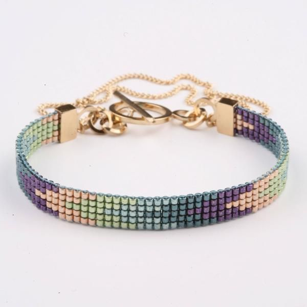 Very pretty, and the findings raise the overall elegance.  Navajo Bracelet - Peacock/Gold | Anabel Campbell