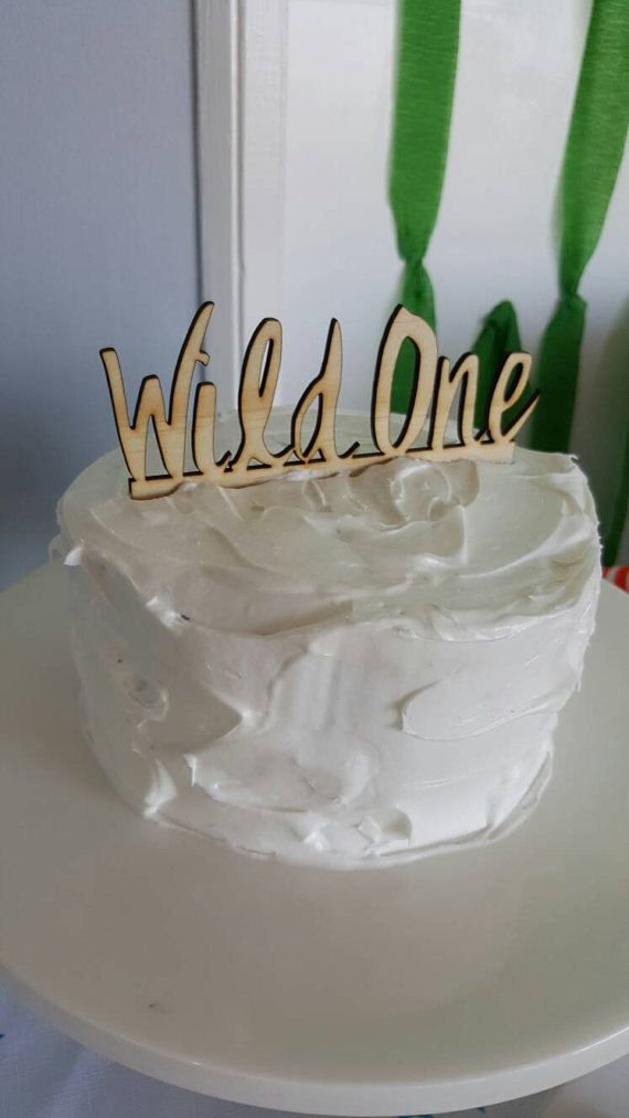 A large WILD ONE cake topper from Katrina Louise Designs. The perfect topper for a first birthday cake.