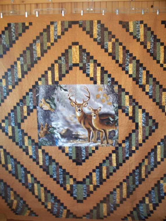 57. This is a beautiful deer quilt with pillow case. Has over 1500 pieces.  Has been machined quilted with Hobbs batting.
