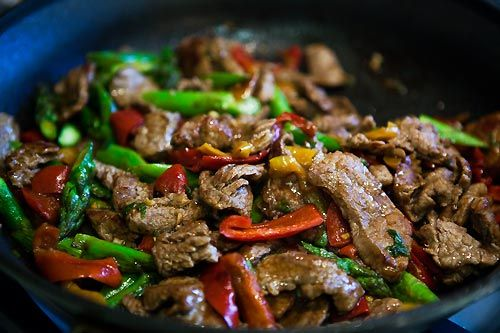 Flank Steak Stir Fry w. Asparagus and Red Pepper. I make mine low carb by not eating it with rice. I make the full 4 servings and it's enough without a starch.