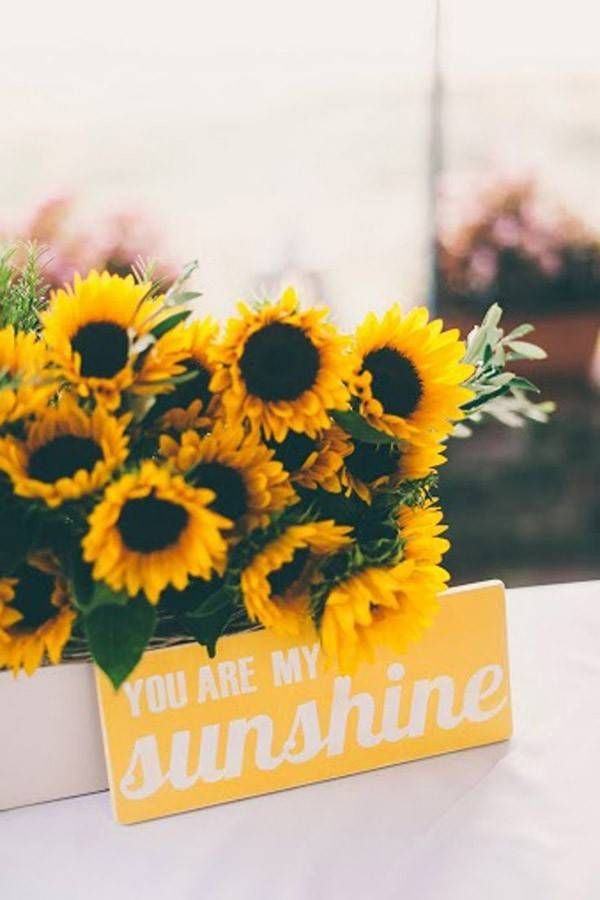 Simple sunflower wedding arrangement and rustic wedding sign