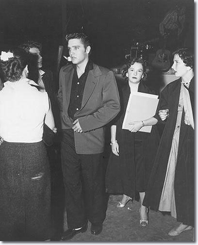 candid Elvis 1956: backstage before an appearance.