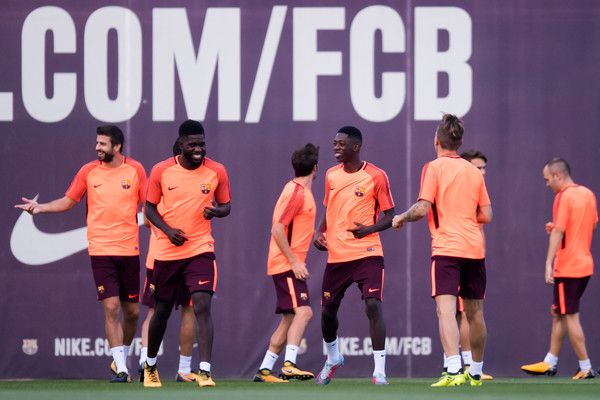Samuel Umtiti, Ousmane Dembele and Lucas Digne of FC Barcelona share a joke during a training session ahead of the UEFA Champions League Group D match against Juventus on September 11, 2017 in Barcelona.