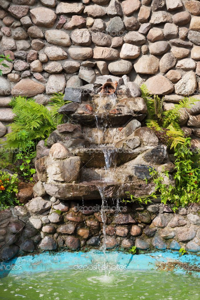 Decorative garden waterfall and pond made of stone ... on Small Backyard Water Features id=26392