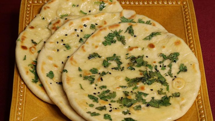 """Kulcha is a soft textured flatbread; this is very popular in northern states of India. They can be made in a tandoor (clay oven) or on a skillet. I am using a skillet. Traditionally kulchas are served with spicy chole (chick peas). This delicious combination is known as """"Chole kulcha"""". This is also another popular street food."""
